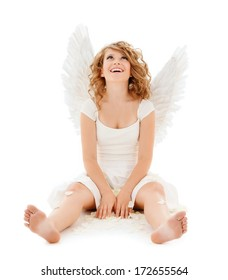 religion, faith, holidays and costumes concept - happy teenage angel girl