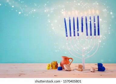 Religion image of jewish holiday Hanukkah background with menorah (traditional candelabra) and dreidels