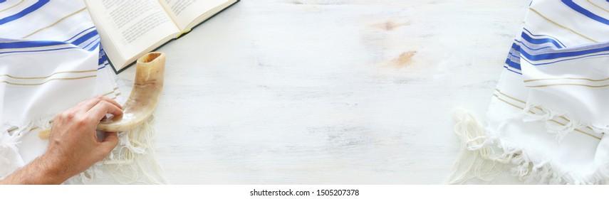 religion image of Prayer Shawl - Tallit, Prayer book and Shofar (horn) jewish religious symbols. Rosh hashanah (jewish New Year holiday), Shabbat and Yom kippur concept. banner