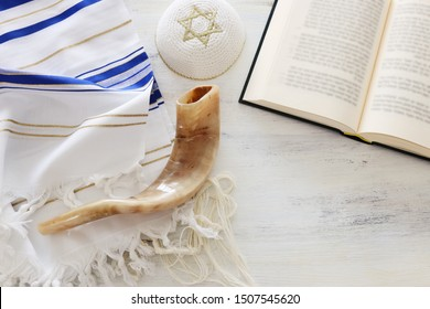 religion image of Prayer Shawl - Tallit, Prayer book and Shofar (horn) religious symbols. Rosh hashanah (jewish New Year holiday), Shabbat and Yom kippur concept.