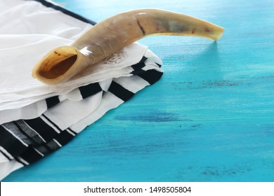 religion image of shofar (horn) on white prayer talit. Rosh hashanah (jewish New Year holiday), Shabbat and Yom kippur concept