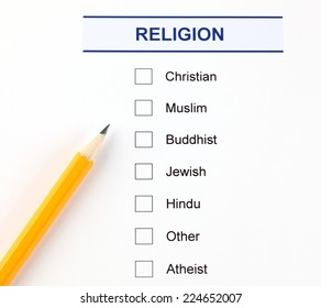 Religion questionnaire with pencil.