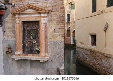 Religious altar artifact on an ancient wall in Venice, Italy Venezia, Italia