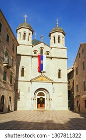 Religious architecture. Montenegro, Old Town of Kotor - UNESCO World Heritage site.  View of Serbian Orthodox Church of St. Nicholas on sunny winter day