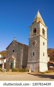Religious architecture. Village church in Mediterranean. Montenegro, Tivat. View of Catholic Church of Saint Roch in Donja Lastva village on sunny winter day