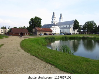 Religious building in Europe, White church in Lithuania with trees background