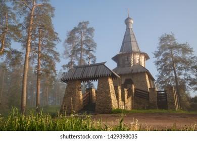 Religious building of a tea house on a foggy morning at dawn near Nikolsky Skete, Valaam Island, Karelia, Russia.