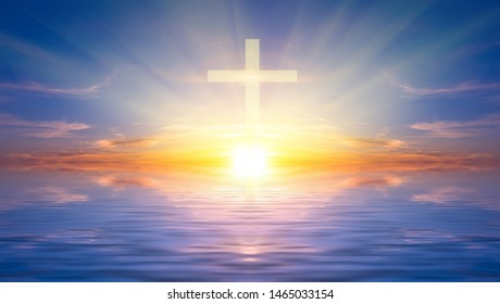 Religious cross against the sunset over the sea, symbolizing the hope of salvation and forgiveness. Religious composition