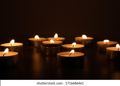 Religious and devoutness scene: candles burning in the dark