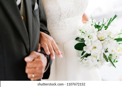 religious event of marriage - Father and daughter with bouquet of orchids