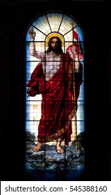 Religious figure on stain glass with back light