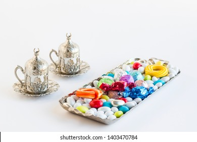 Religious Holiday, The Sugar Feast After Ramadan with colorful candies and chocolates in the long metal tray with coffee cups.