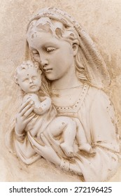 Religious icon (bas-relief) of Madonna with child on a house facade in Mdina, Malta.