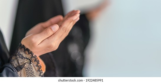 religious islamic background of hands of muslim prayer woman with rosary in dua praying for allah blessing in mosque