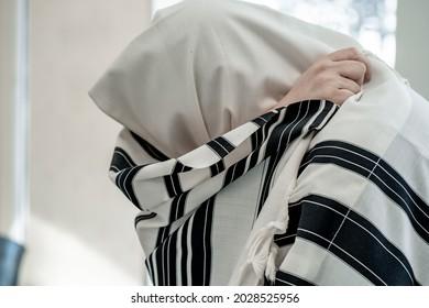 Religious jew prays in a tallit. Jewish prayer - Shutterstock ID 2028525956