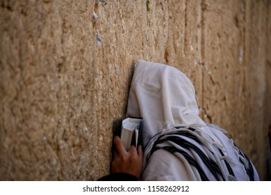 Religious Jews pray at the Western Wall in Jerusalem. Prayer of the Coens in honor of the Jewish holiday Pesach