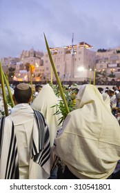 Religious Jews sunrise prayer service at the Western Wall, Jerusalem, Israel