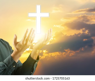 Religious man praying outdoors against cloudy sky