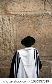 Religious Man Praying at the Western Wall in Jerusalem