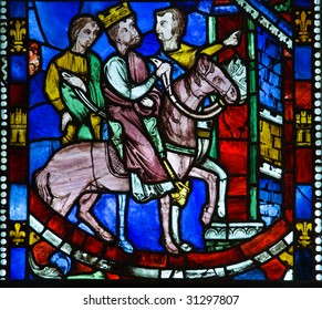 Religious medieval stained glass window in cloister New York - details