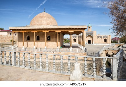 Religious Muslim complex Chashma - Djuma mosque with a source in the foreground and Namazgokh mosque in the background. Nurata, Uzbekistan