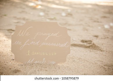 Religious psalm sign in the sand at the beach.