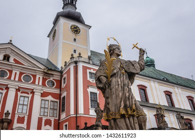Religious statue in front of St Adalbert Church of Benedictine Abbey in Broumov town in Czech Republic