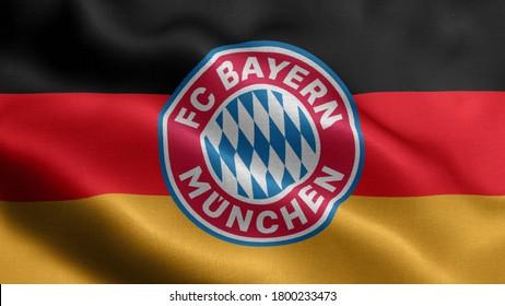 religious symbols of bayern munich. close up waving flag of bayern munich. bayern munich symbols on flag background.