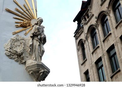The religious symbols and signs are found in the buildings in  Antwerp, Belgium