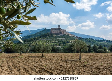 The Religious village of Assisi stands on a hilltop overlooking arable land