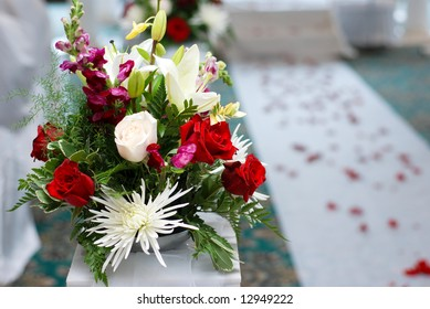 Religious wedding ceremony, nice wedding bouquet is right next to the final aisle to marriage.