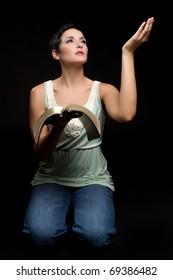 Religious woman reading christian bible
