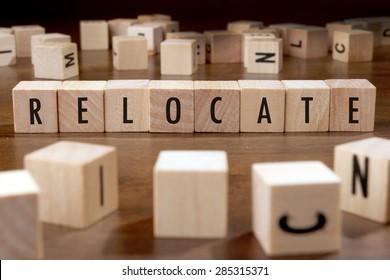 RELOCATE word written on wood block