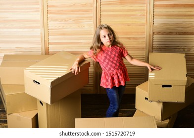 Relocating family can be exciting, but also stressful for kids. Kid girl relocating boxes background. Relocating concept. Delivery service. Box package and storage. Small child prepare for relocation.