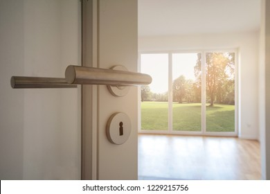 Relocation, Moving to new apartment - Door to modern living room with view to garden