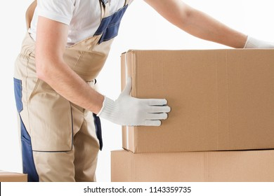 Relocation services concept. Mover in uniform with cardboardboxes isolated on white background.