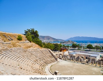Remains of the Amphitheatre of Halicarnassus with Kumbahce bay and the Castle of Saint Peter in the background. Mugla Province, Turkey.