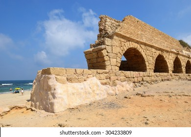 remains of ancient roman aqueduct at Ceasarea along the coast of the Mediterranean Sea, Israel