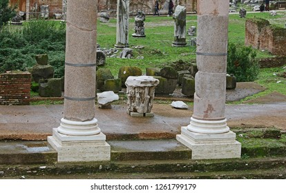 Remains of ancient Roman columns seen from the street in the Forum of Augustus showing the bases of the columns with a Corinthian or Composite style captial between them probably around 2BC