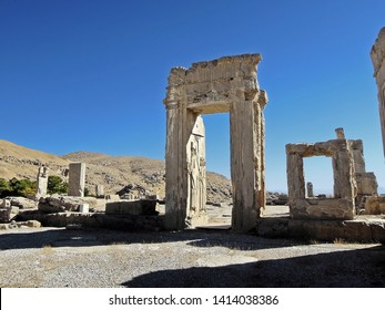 Remains of archs in Palace of Xerxes. Central arch has relief of Persian king & his servants, holding umbrella under his head. Fire, destroyed this city, began from here. Persepolis, near Shiraz, Iran