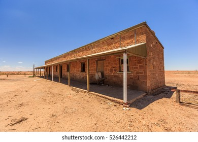 Remains Beresford Station at the Old Ghan railway  and no longer in use against a beautiful blue sky