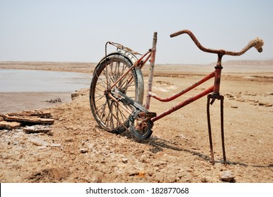 Remains of a bicycle at Dead Sea coast