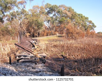 Remains of a burned down foot bridge after bush fire in an suburban area of Knox City in Melbourne east