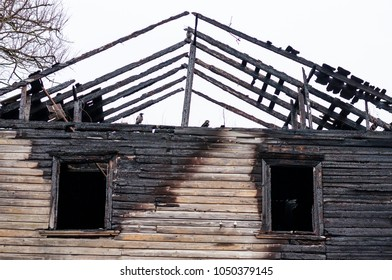Remains of the burnt wooden house facade