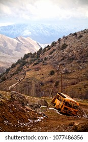 The remains of the bus in the abyss. Landscapes of Middle Asia (Uzbekistan)