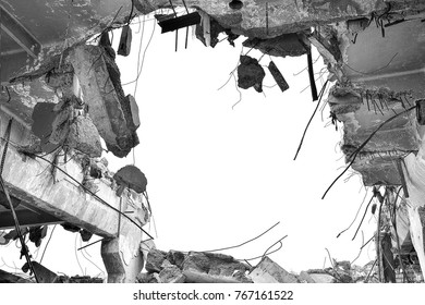 Remains of the destroyed industrial building. Black-and-white image.
