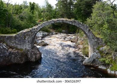 Remains of humpback rubble filled Packhorse Bridge (built 1717) at Carrbridge, Scotland
