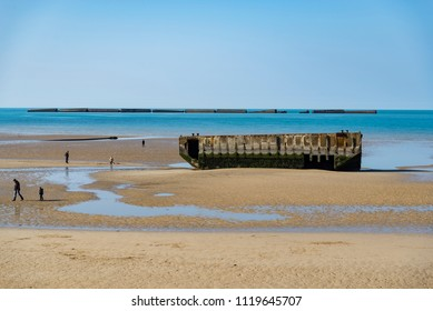 The remains of the Mulberry Harbour at Arromanches