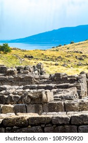 Remains of old Roman and Byzantine era buildings, with the Sea of Galilee in the background, in Korazim National Park, Northern Israel