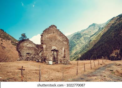 Remains of old ruined church, Dartlo village. Adventure holiday in Tusheti. Travel to Georgia. Mount landscape. Green ecology tourism. Countryside nature. Copyspace. Eco trekking tour. Dirt road